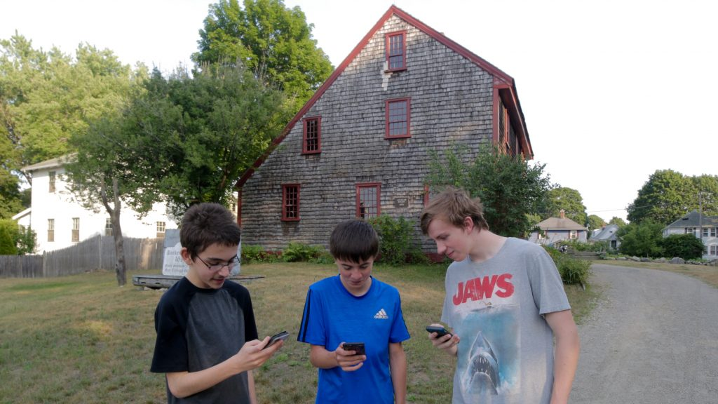 Jake Baker, Trevor Kinney, Andrew DeRusha hunting for Pokémon at Parker Tavern on Washington Street