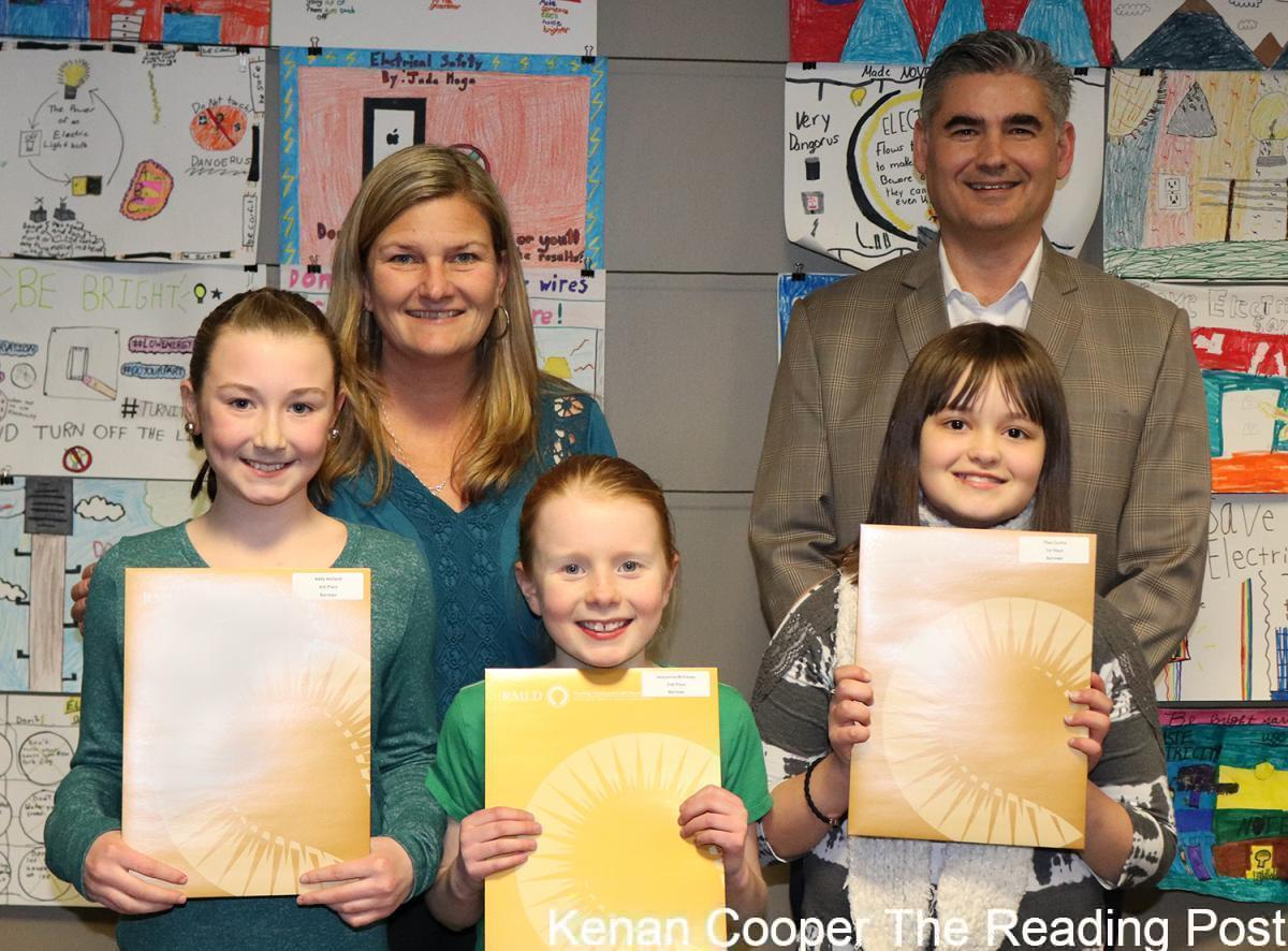 Alice M. Barrows, Reading:Back (L to R): Beth Leavitt, principal; Dave Hennessy, RMLDFront (L to R): Addy Holland, third place winner; Jacqueline Belliveau, second place winner; Thea Cunha, first place winner